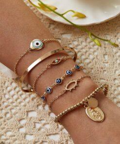 Ensemble de 6 bracelets d'été or avec petit yeux bleu
