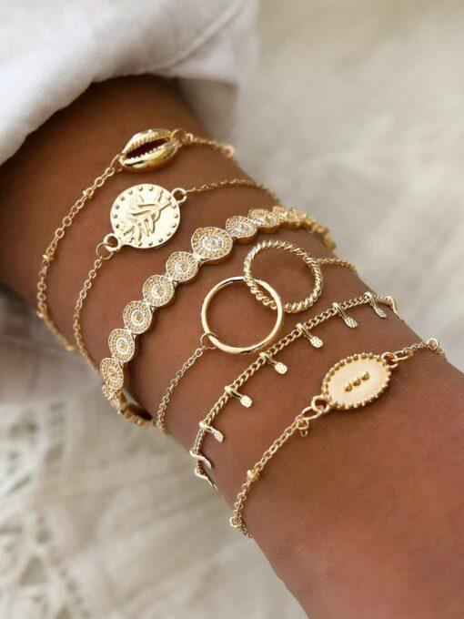 Ensemble de 6 bracelets or avec coquillage cauri